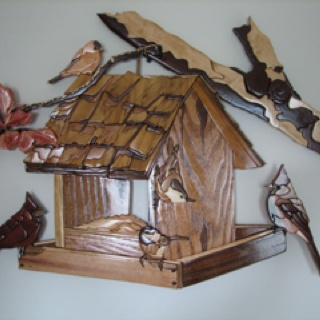 Birdhouse made using different species of wood for color.  It's flat and hangs on the wall