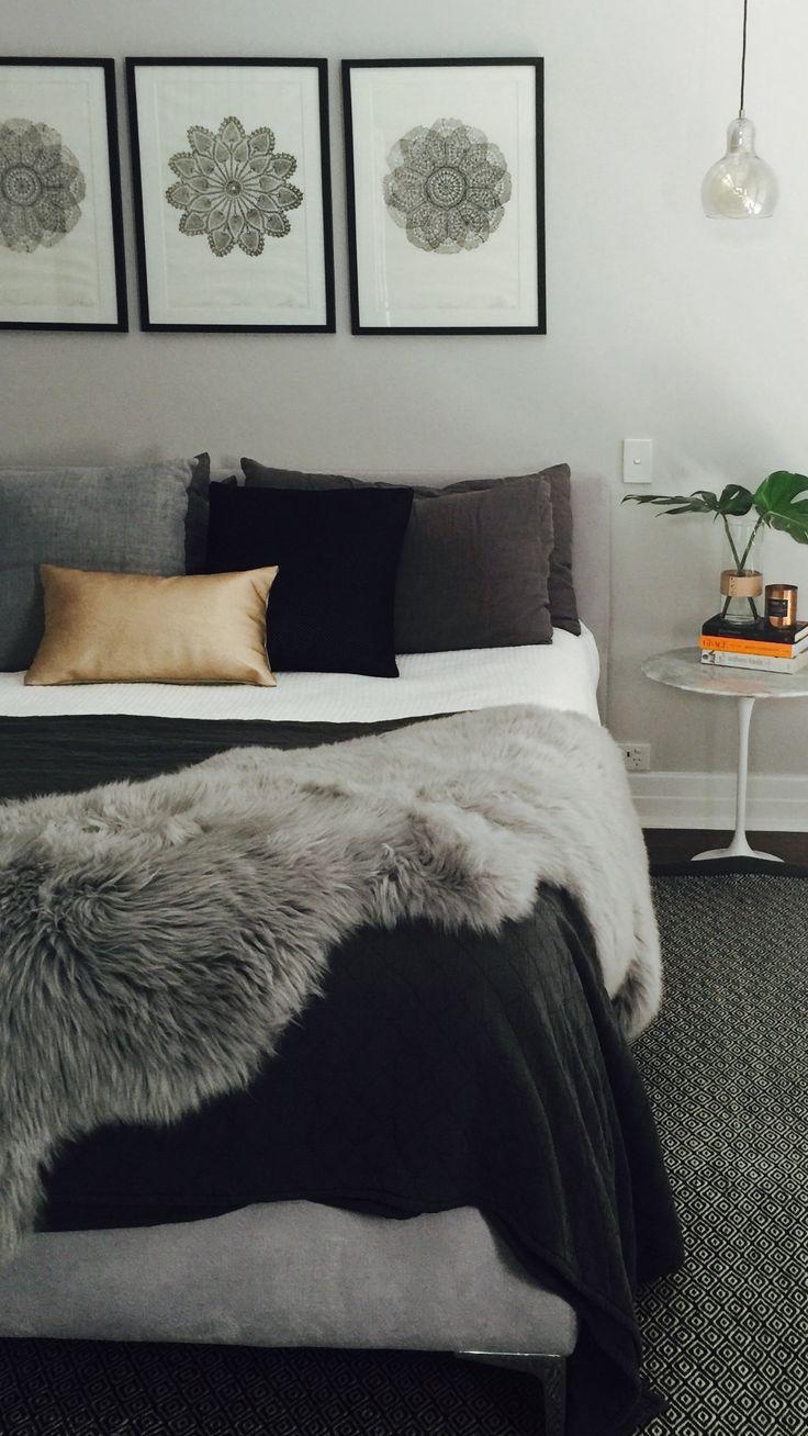 Grey bed, grey walls, Scandinavian style, mandala artwork, Great Dane pendant light, sheepskin throw, metallic cushions, marble table