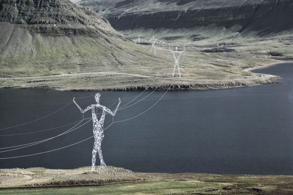 Mundane electricity pylons are transformed into works of walking giant art