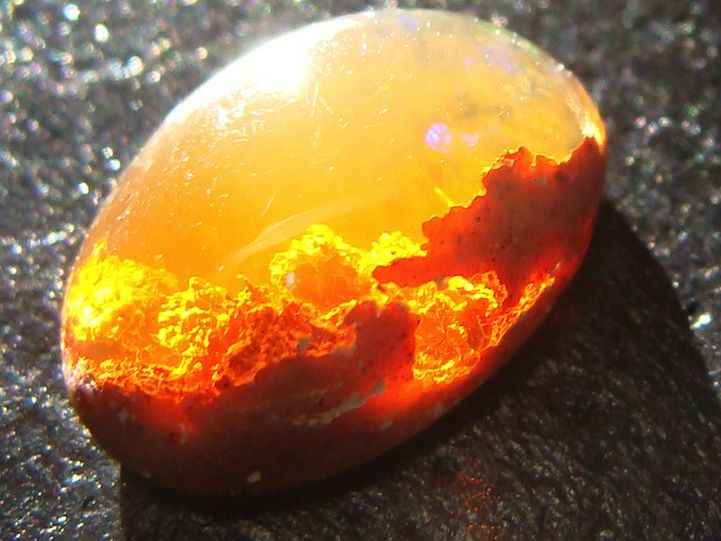 Florida-based gemstone enthusiast Jeff Schultz captures a stunning image of a Mexican Fire Opal that, depending on how you visually interpret it, looks like a beautiful sunset in the clouds or a fiery explosion with billowing smoke.
