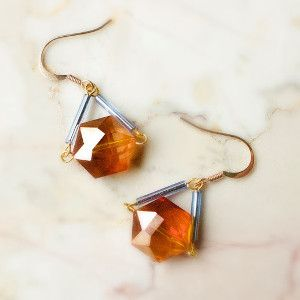 With these Easy and Gorgeous Geometric Earrings, you really have the best of of both worlds. The charming crystals give these DIY earrings a dressy look while the stylish bugle beads lend a casual vibe. Thus, you have a pair of DIY jewelry pieces that are versatile enough to wear to both formal and informal occasions.