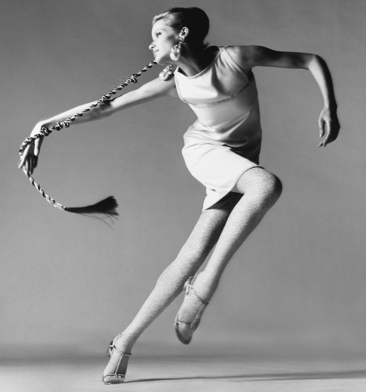 Richard Avedon. I love the lines formed in this image punctuated with the curve of the braid. Lighting is sensational as well