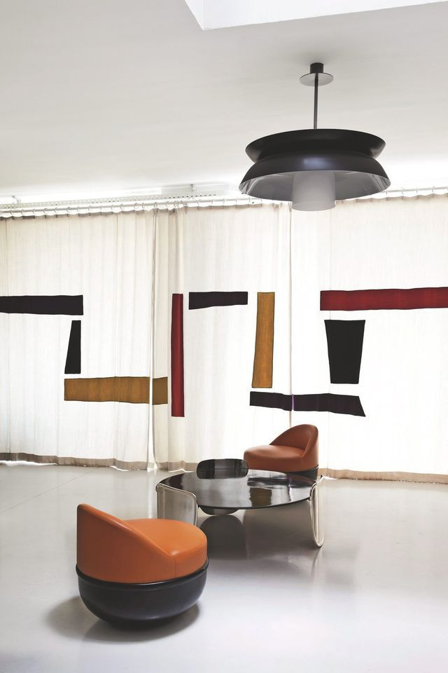 """Before the linen curtain with applications designed by Eric Schmitt and directed by Polybius and Malet, armless """"Shell"""" leather and bronze and coffee table in bronze and silver plated.  Suspension """"Marceau"""" lacquered aluminum."""
