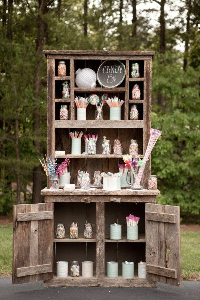 adorable candy bar with recycled tin cans and mason jars