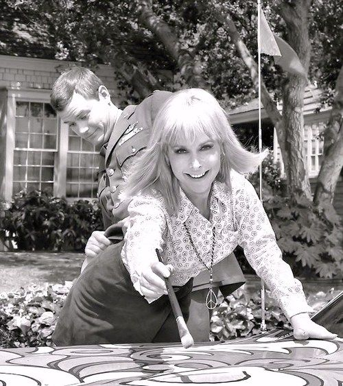 "Larry Hagman and Barbara Eden on the set of ""I Dream Of Jeannie."" Such a cute picture."