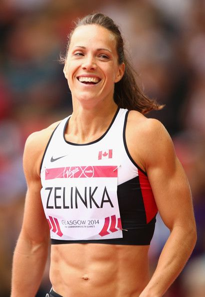 Jessica Zelinka Photos Photos - Jessica Zelinka of Canada smiles after competing in the Women's Heptathlon 100 metres hurdles at Hampden Park during day six of the Glasgow 2014 Commonwealth Games on July 29, 2014 in Glasgow, United Kingdom. - 20th Commonwealth Games: Athletics