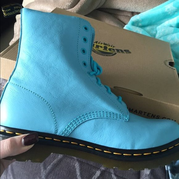 Wild Aqua Pascal Dr. Martens Women's size 10, I bought them online for $170 around Christmas. They're so pretty but just not my style. They've never been worn and they're still wrapped in the box. Asking $130 OBO. I'm at Ann RD & 215 and willing to meet. Dr. Martens Shoes Combat & Moto Boots