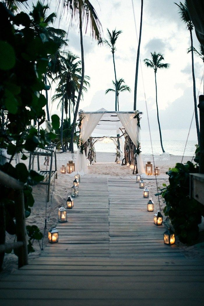 b8b6f448 tall palm trees, on a sandy white shore, wooden boards leading to a simple  wedding tent, made from wooden poles and white cloth, beach wedding venues,  ...