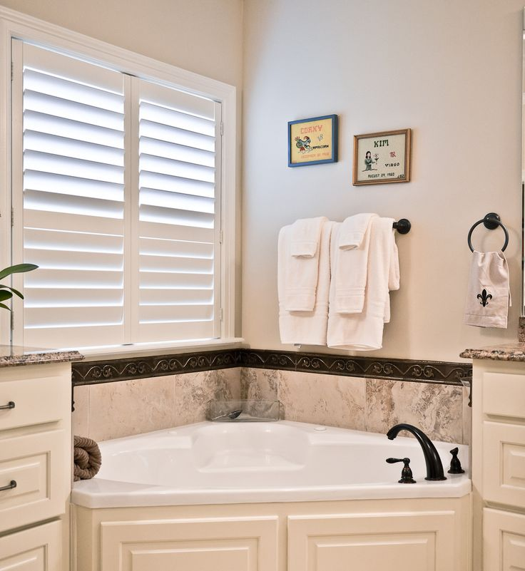 Poly plantation shutters won't warp in humid conditions like bathrooms. A great option!