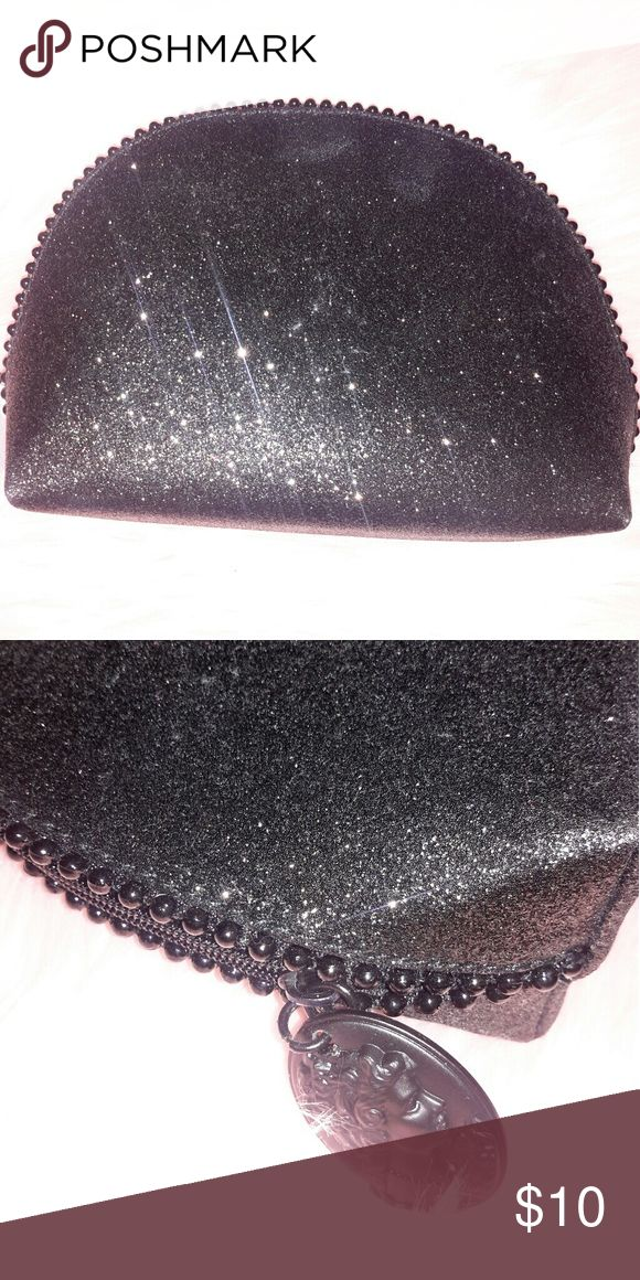 MAC Makeup Bag MAC glitter makeup bag from the 2014 Keepsake Holiday Collection.  Bag has never been used. MAC Cosmetics Makeup