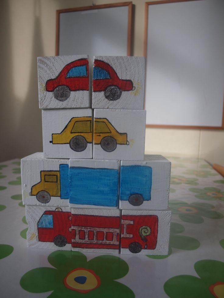 puzzelblokken met op de achterkant een zelfcontrole (puzzelblokken met op de achterkant éénzelfde gekleurd vierkant horen bij elkaar)