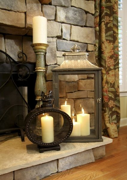 Adding candles and lanterns to fireplace hearth.