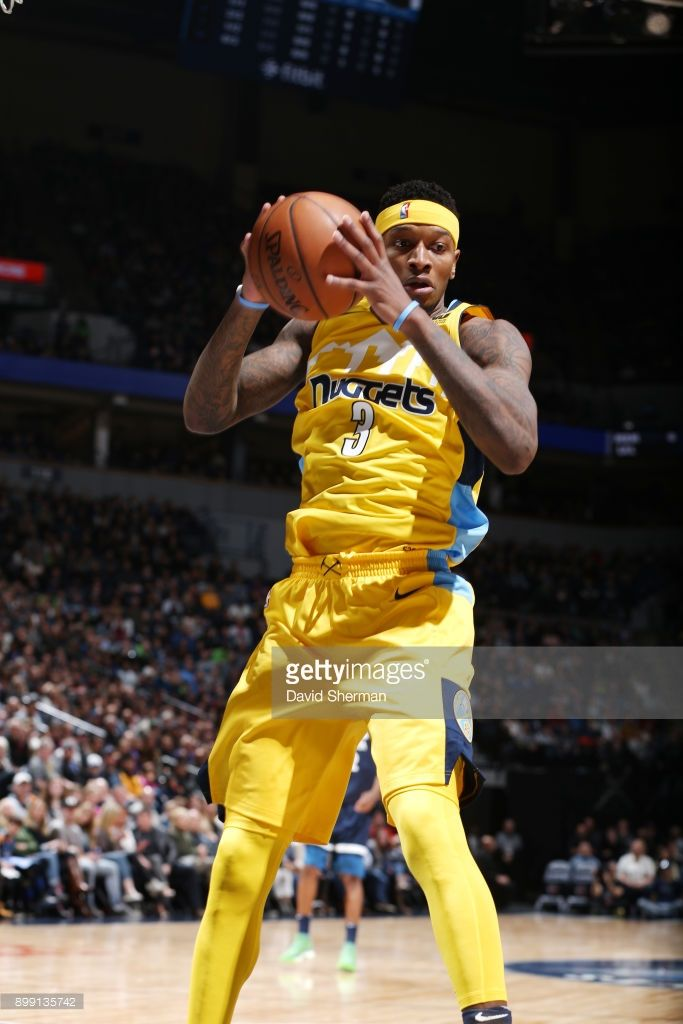 Torrey Craig #3 of the Denver Nuggets handles the ball against the Minnesota Timberwolves on December 27, 2017 at Target Center in Minneapolis, Minnesota.