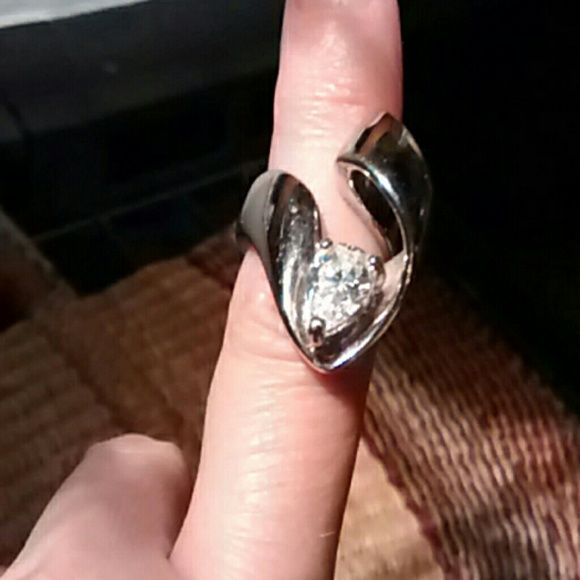 Cocktail ring Silver plate ribbon design band ring with large beautiful CZ, over 1 karat.  Size 5.5.  A way cool and striking piece.  Is new, seldom worn..my fingers grew! Jewelry Rings