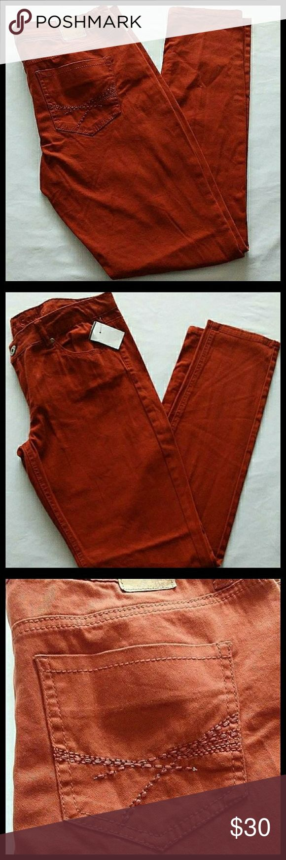 """New Red Camel Jeans * New without tags never worn * Belt loops * Button and zipper front closure * Front and back pockets * Design on pockets * Burnt orange color * Waist 34.5"""" * Inseam 31"""" Red Camel Jeans"""