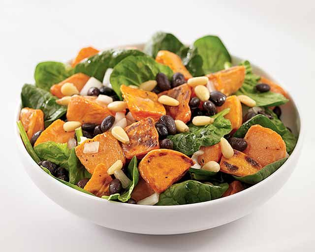 Roasted Sweet Potato and Spinach Salad Recipe - Sweet potatoes are low in fat and loaded with vitamin A, fiber and potassium...essential nutrients. #Schwans #EasyRecipes #Inspiration