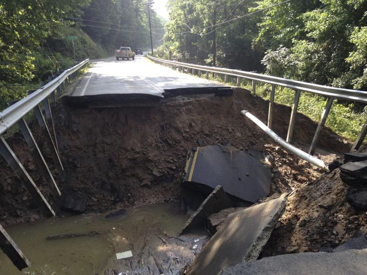<p>The West Virginia State Highway 4 along the Elk River shows extensive damage after flood water has dropped in the Clendenin, West Virginia, June 25, 2016. hit by flooding. (West Virginia Department of Transportation/Handout via REUTERS) </p>