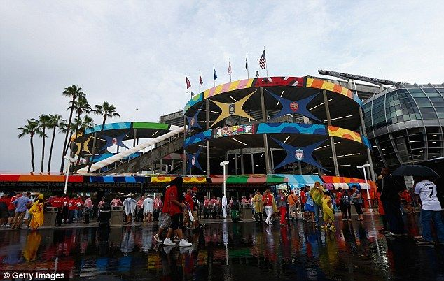 Soaked: The rain had hit the Sun Life Stadium in Miami hard before kick-off for the final...