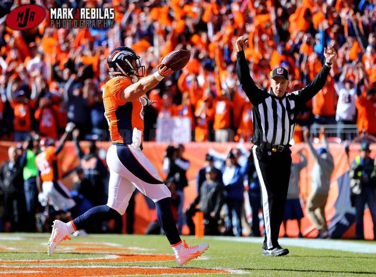 Canon 1Dx, 70-200mm, 640iso, f2.8, 1/8000th, Aperture Priority Denver Broncos tight end Owen Daniels (81) celebrates after scoring a touchdown against the New England Patriots in the first quarter in the AFC Championship football game at Sports Authority Field at Mile High. Mandatory Credit: Mark J. Rebilas-USA TODAY Sports