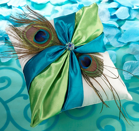 The Peacock Ring Pillow is certainly a must have for the contemporary couple planning a peacock theme wedding.