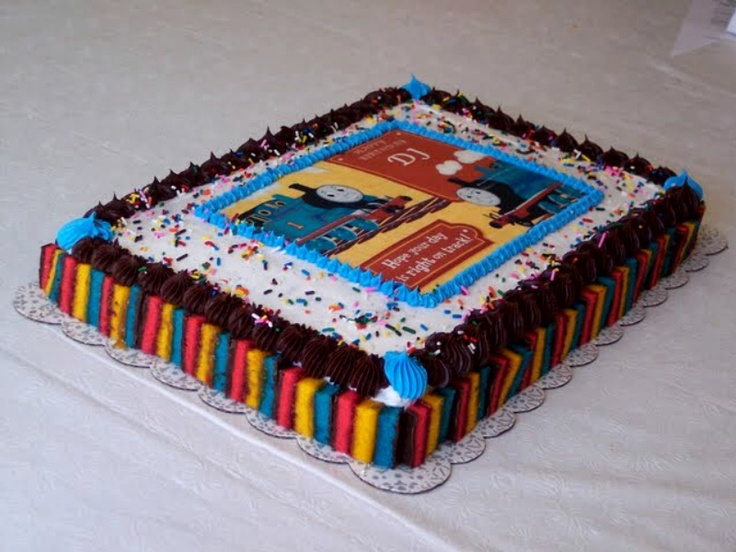 Boy's Thomas the Train Birthday Cake - Chocolate & Vanilla Cake with Rainbow Cookies around cake.  It's also filled with chocolate & vanilla pudding