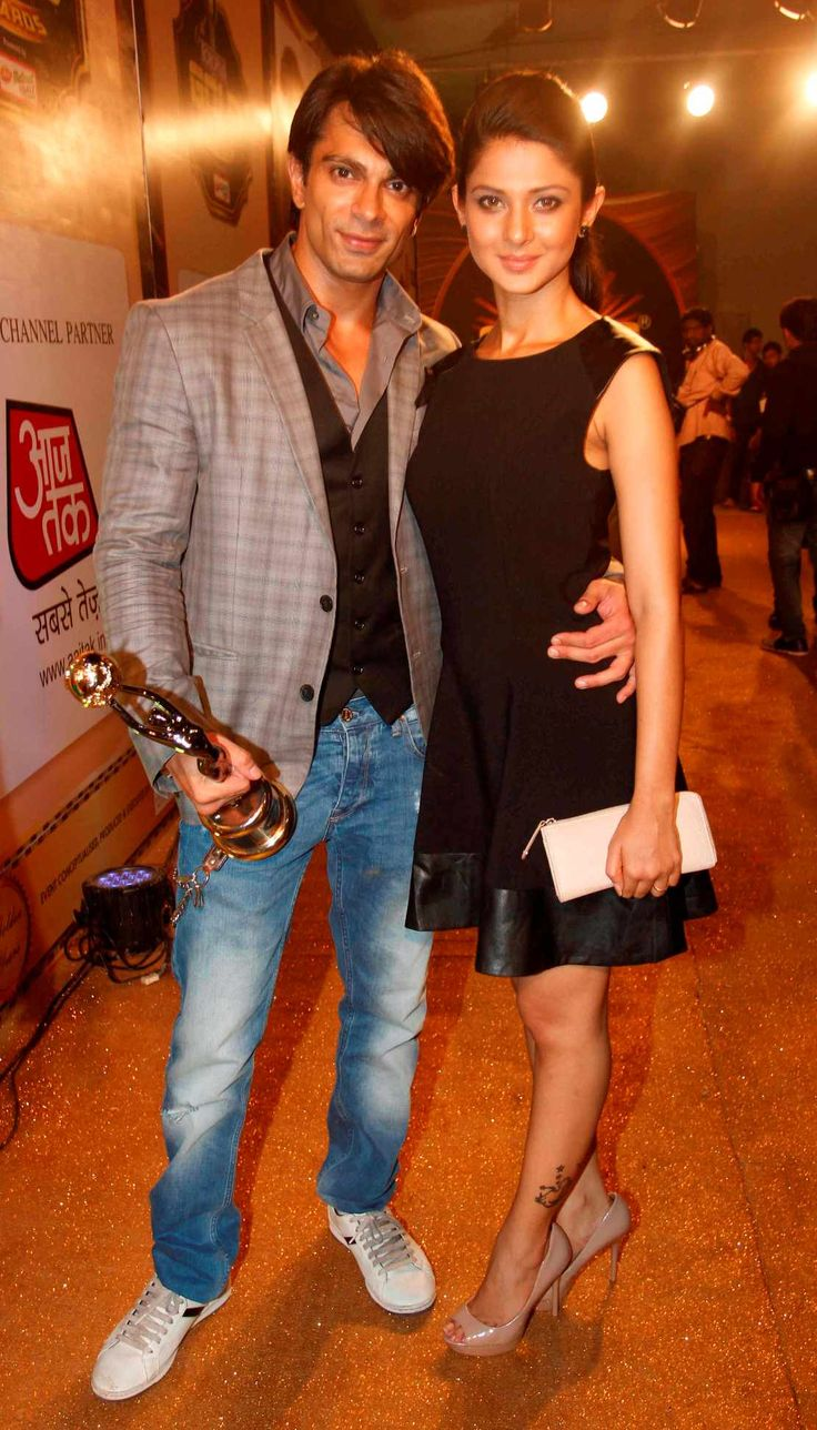 Television's sweethearts Karan Singh Grover and Jennifer Winget walk the Gold Carpet at the Boroplus Gold Awards