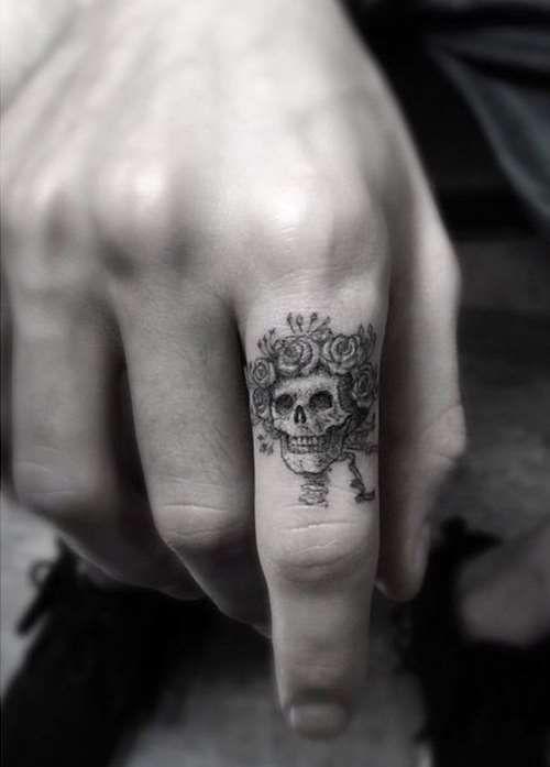 Skull tattoo on finger - Dr. Woo?