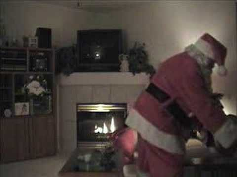 This video was taken on Christmas morning at 1:04 am in 2004. After the clock chimes at one o'clock, the sound of sleigh bells and hoofs are heard. Then footsteps accross the roof and then magically Santa appears in front of the fireplace. Getting to work he fills the stockings and has a snack. St. Nick lays his finger aside his nose and as quic...