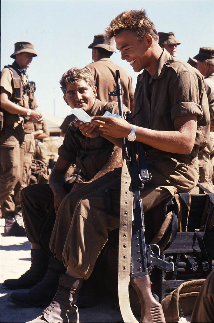 South African troop - reading his letter before going on patrol