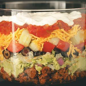 Tasty Layered Taco Salad. I made this for recipe club the other day. I omitted the onions and cucumbers and used less sour cream. Easy to make and taylor to your taste.