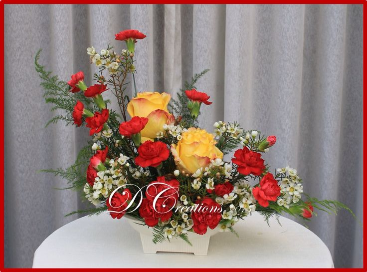Red carnations and peach roses makes a cute arrangement