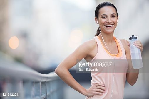 Stock Photo : Woman drinking water outdoors