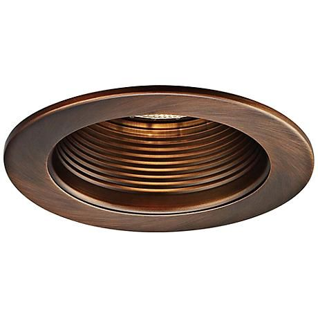 This line voltage copper bronze recessed downlight trim with interior step baffle from WAC Lighting is crafted from durable stamped metal and is UL listed for damp locations