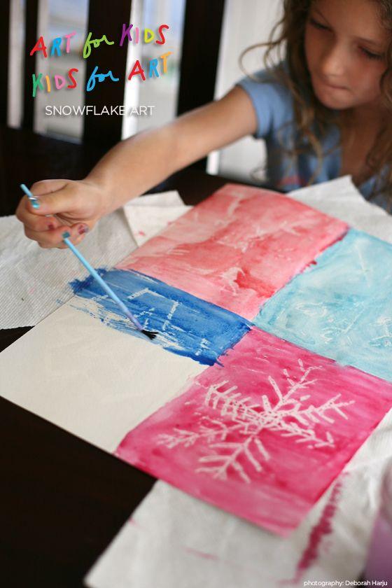 snowflake art project using crayon resist and watercolors