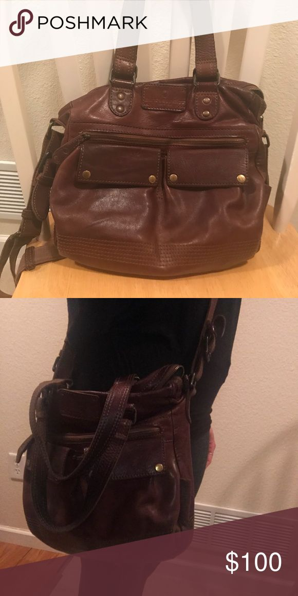 Aunts and Uncles Handmade Leather Cross Body Bag This is a hand crafted bag that retailed at $400 and was purchased in 2014. It's been very loved however I do not use it anymore. It can be carried by the handles or with an adjustable strap over the shoulder. aunts and uncles Bags Crossbody Bags