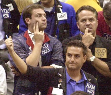 Vince D'Agostino (VXD), Joe Dicaro (J0JO) and Evangelos Malfas (AXM) watch the boards as trading nears an end for the week in the S&P 500 Futures trading pit Friday, Aug. 9, 2002, at the Chicago Mercantile Exchange.