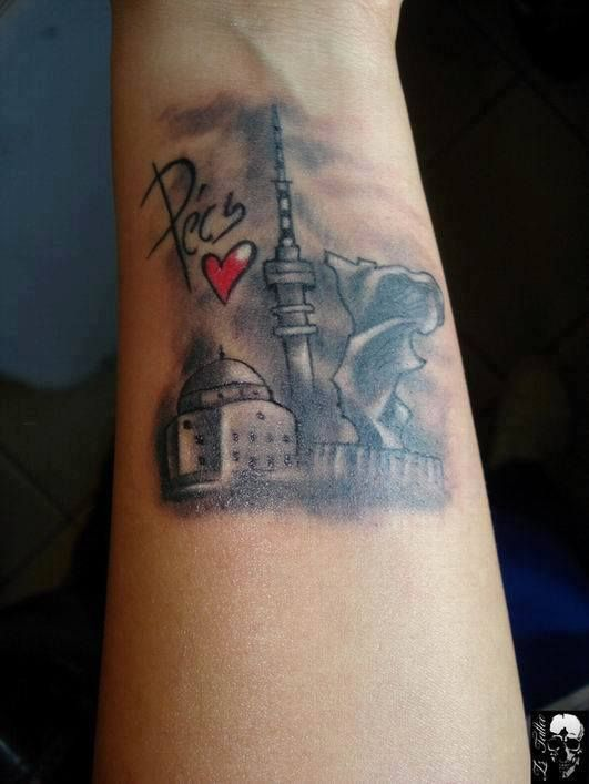 tattoo of the city of Pécs (shame it wasn't done on the pecs really)