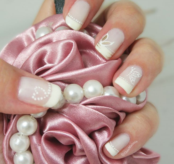 Like the polka dotted heart on the thumb nail. Would be cute at valentines day for nail art.