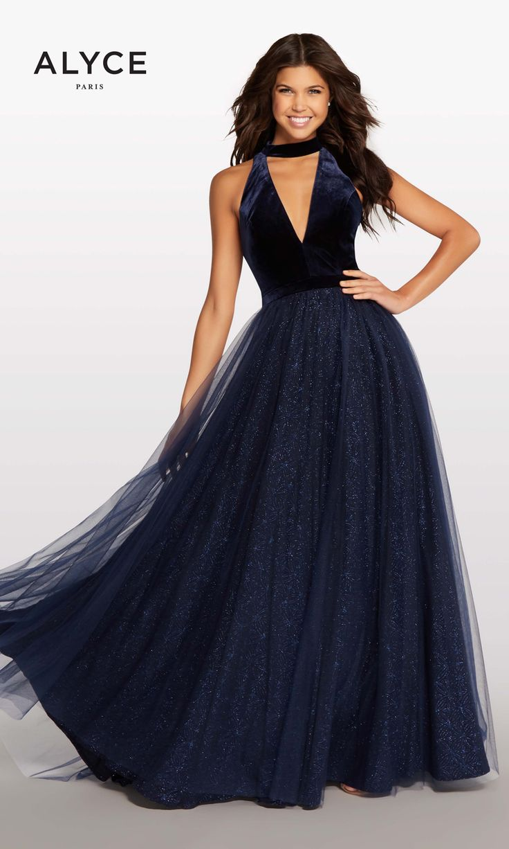 This Kalani Collection by Alyce Paris KP105 prom gown features a velvet bodice with a plunging choker-halter neckline, complemented with a cutout back. This A-line dress finishes in a fully gathered skirt, comprised of tulle over a sequined underlay. Available in sizes XXS to XL. #KalaniHilliker #Kalani #AlyceParis #promdresses #promdress #prom2018