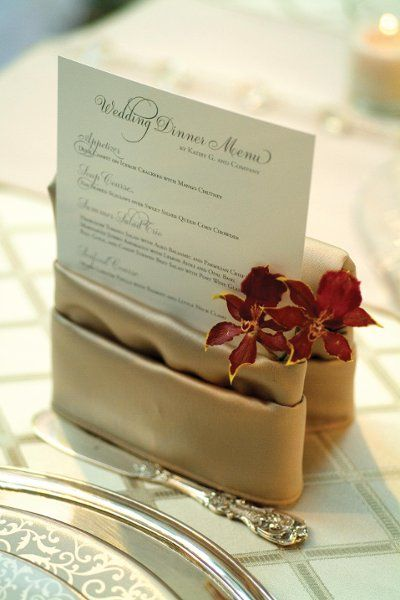 love how the menu is displayed within this unique napkin fold