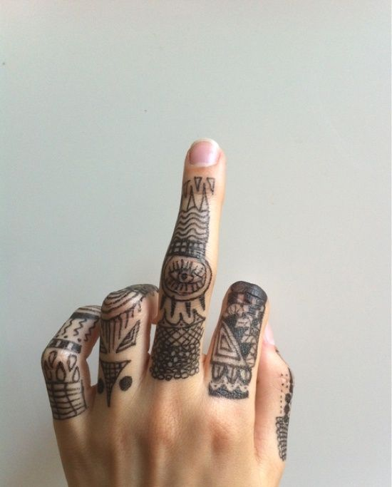 I apologize for the finger, but those tattoos are pretty awesome...