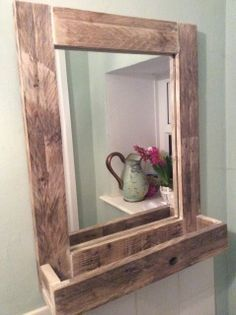 Bathroom Mirror made from reclaimed pallet wood with section for storage  Dimensions:- 60cm long 49cm wide 12cm deep   This item can be made to your individual specification if required.  Price includes £10.50 for delivery
