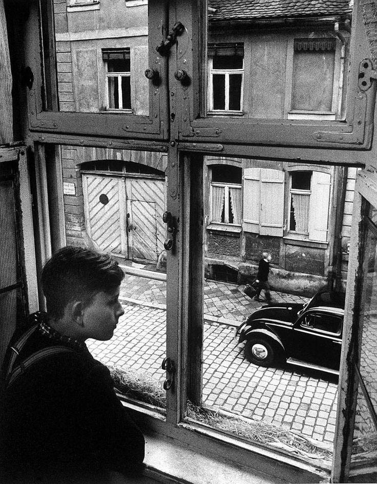 Carl Mydans - Boy at the window, Ansbach, Germany, 1954