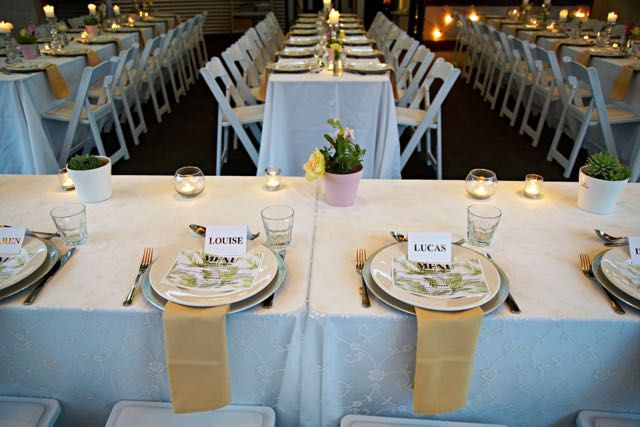 Love the gold long napkins and the long tables.