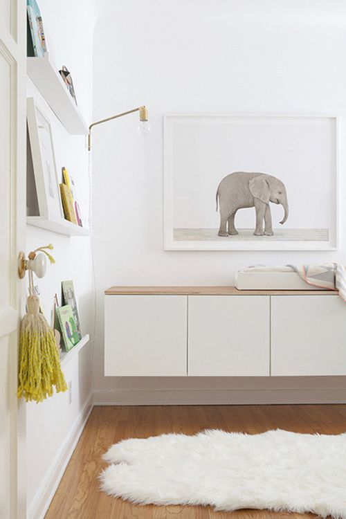 A cute and modern baby room - I like the print of the elephant