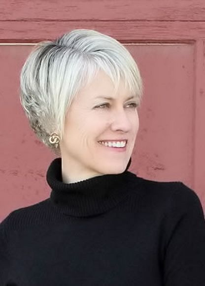 short hairstyles women over 50 side bangs and blonde color