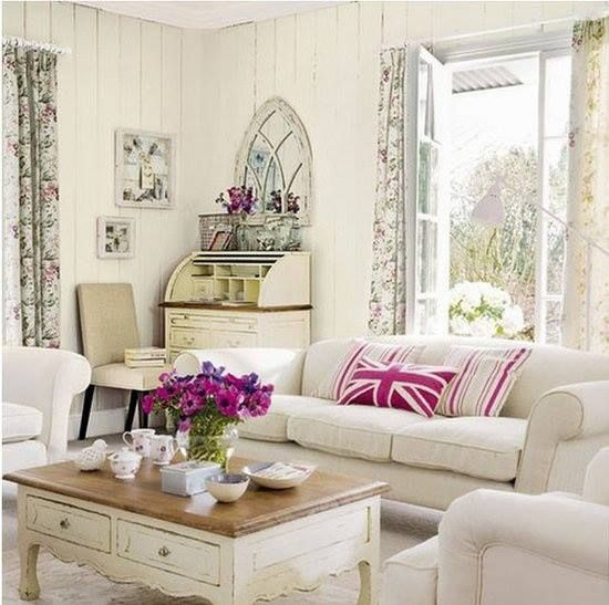 Do NOT like the floral curtains or the Union Jack pillows, but there's something about this room that I like. Maybe the pop of color?