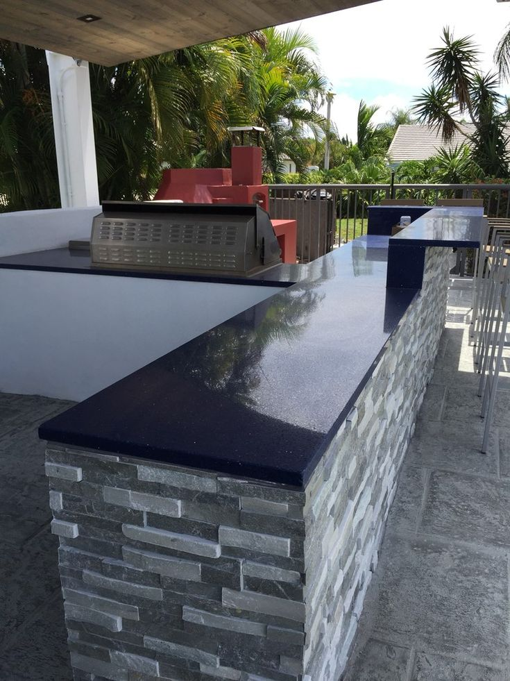summer kitchen with grey stones counter with black polished marble top and barbeque grill of Welcoming Summer with Cooking Al Fresco