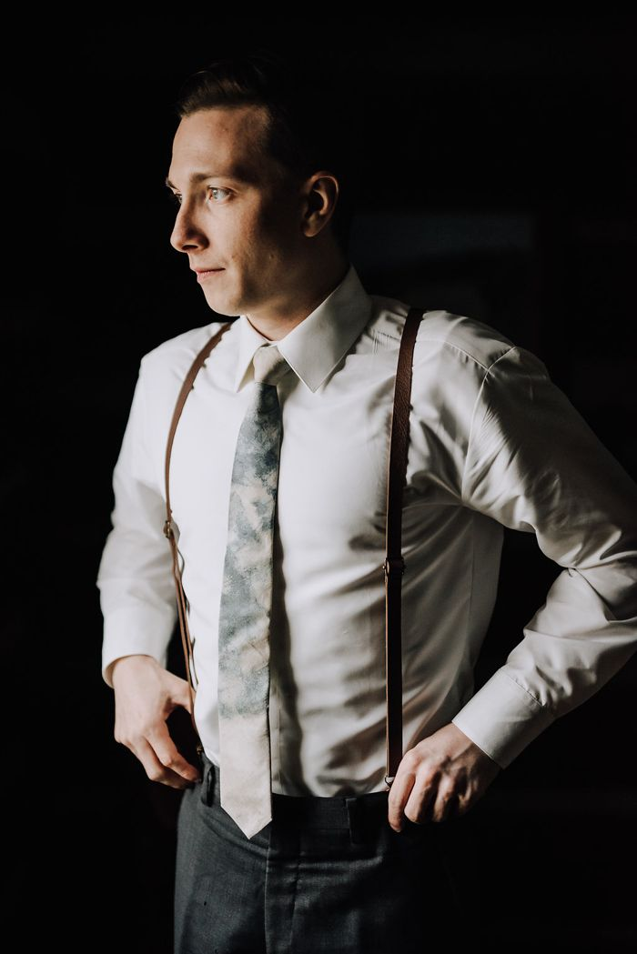 Suspenders + a marble-patterned tie for this stylish groom   Image by Swak Photography