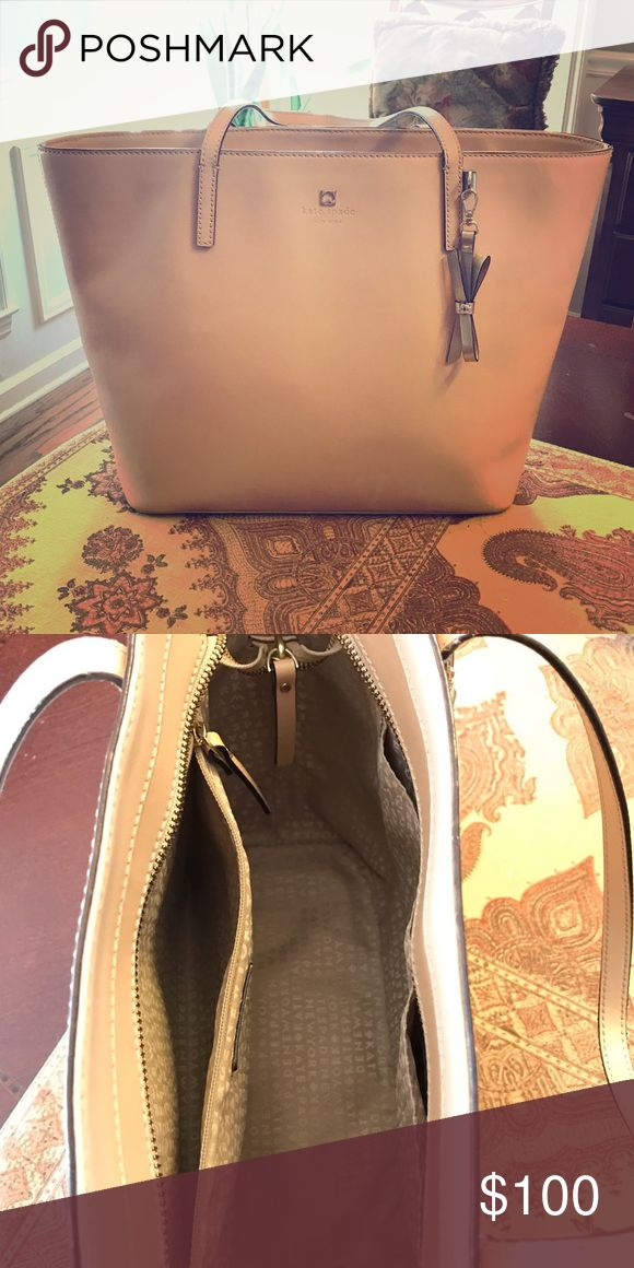 Large skate Spade neutral tote Large well cared for Kate Spade tote. Has some minor wear on handles. It's a beautiful bag and can hold anything you'd need. Kate Spade Bags Totes
